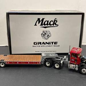 Lot# 9 - First Gear 19-3298 Mack Granite Tractor with Lowboy Trailer 1:34 Scale