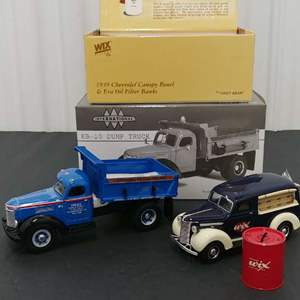 Lot# 132 - 2 Qty. First Gear # 19-2772 KB-10 Dump Truck * DH&L 1:43 * # 29-2303 '39 Chevy Canopy Panel Bank * Wix