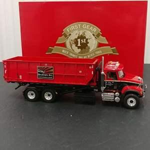 Lot# 136 - First Gear # 10-3408 Mack Granite Roll -off Refuse Truck * Ray Bros. Inc.* 1:34