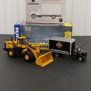 Lot# 149 - 2 Qty. First Gear # 59-0174 International Straight Truck*International *1:54* #50-3121 Wa500 Wheel Loader*Komat'su