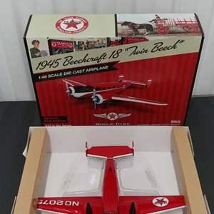 Lot# 154 - Wings of Texaco # CP7151 1945 Beechcraft 18 * Texaco * 1:48