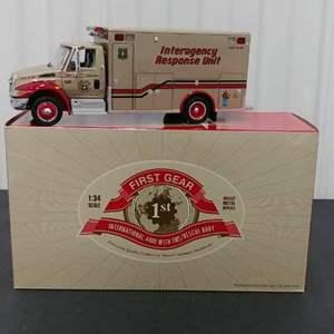 Lot# 172 - First Gear #18-3403 International 4400 w/ EMS/Rescue Body * Smokey Bear * 1:34