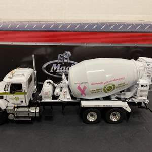 Lot# 195 - FIRST GEAR * 19-3852 Mack Granite with Bridgemaster Mixer * Breast Cancer * 1:34 Scale