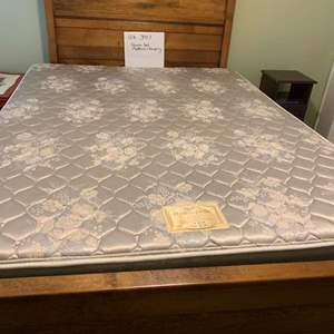 Lot# 22 - Queen bed Frame plus Less than one year old mattress in perfect condition * smoke and pet free house
