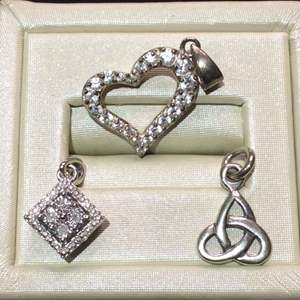 Lot 5- Vintage Sterling Silver Pendant Collection Including Celtic Knot, Heart with Stones, and Geometric Pattern with Stones