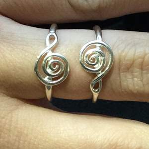 Lot 7- Vintage Sterling Silver Rings creating Treble Clef Design, size 6 and size 7