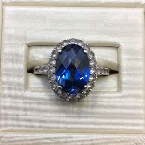 Lot 12- Vintage Sterling Silver Ring sz 8 with 12x8 mm Oval Faceted Cut Blue Stone and White Stones, missing one melee on shank