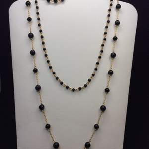 """Lot 43- Vintage 30"""", 17"""" and 7"""" Trio of Black and Yellow Link Necklaces and Bracelet."""