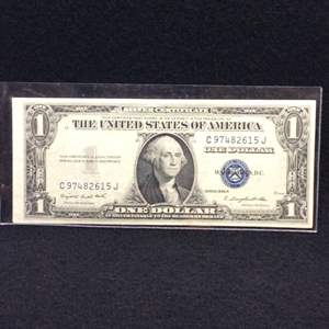 Lot 112 - 1935 G United States One Dollar Silver Certificate Currency Note, Blue Seal.  Uncirculated, Cut Off Center.