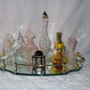 Auction Thumbnail for: Lot 15 - Vintage Perfume Bottles on Mirrored Surface