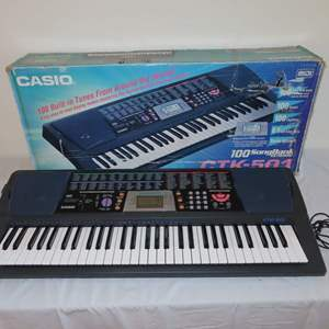 Auction Thumbnail for: Lot 20 - Casio Keyboard with Built-In Music and Great Sound