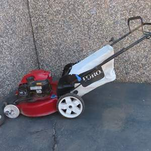 Auction Thumbnail for: Lot 48 - Toro Self Propelled Rear Bag Mower with Broken Wheel
