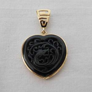 Auction Thumbnail for: Lot 101 - 14K Gold and Black Jade Heart Pendant