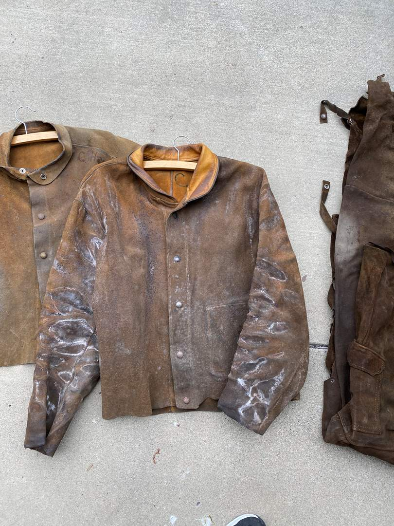 Lot # 92 - VINTAGE FULL LEATHER 2 WELDING JACKETS & CHAPS (main image)