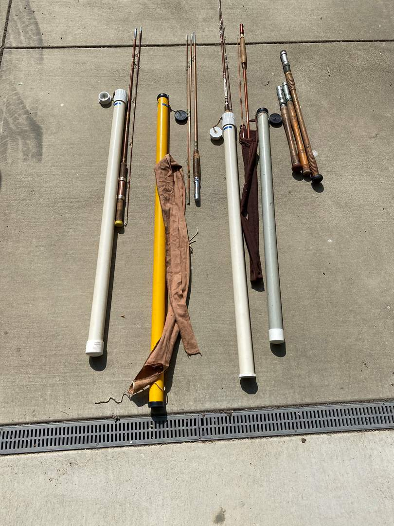 Lot # 95 - FISHING POLES W/STORAGE CONTAINERS (main image)
