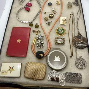 Lot # 134  - VINTAGE JEWELRY IN GLASS-TOP DISPLAY CASE