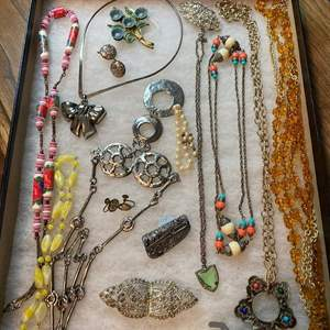 Lot # 175  - VINTAGE JEWELRY IN GLASS-TOP DISPLAY CASE