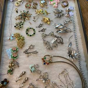 Lot # 176  - VINTAGE JEWELRY IN GLASS-TOP DISPLAY CASE