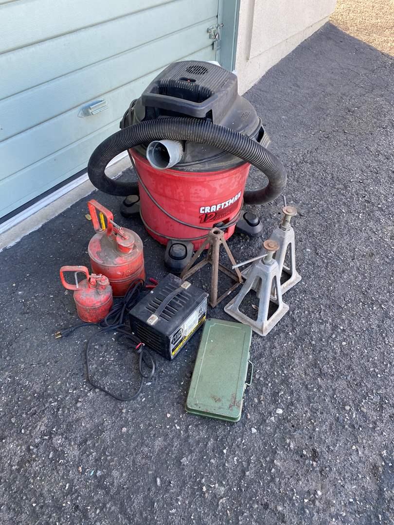 Lot # 80 - BATTERY CHARGER - GAS CANS - SOCKET SET - JACKS & SHOP VAC (main image)