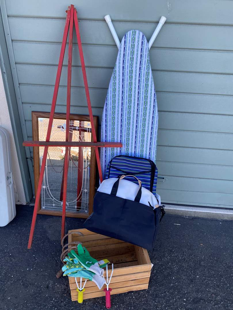 Lot # 141 - Ironing Board, Easel, Decor and Garden Items (main image)