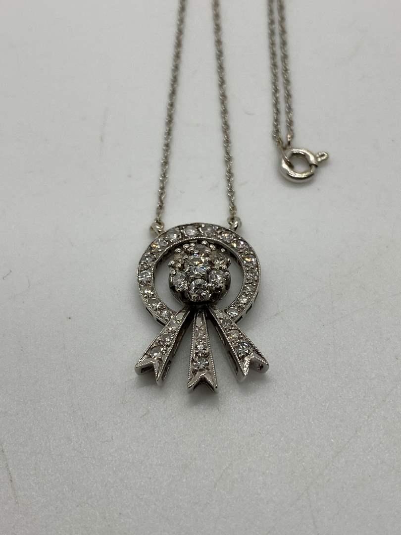 Lot # 44 - 14k Gold Necklace with Diamond Studded Pendant (32 total Diamonds) (main image)