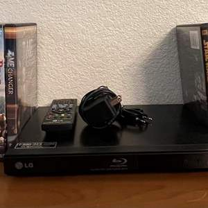 Lot# 90- LG Blu Ray Disc Player with Collection of Videos