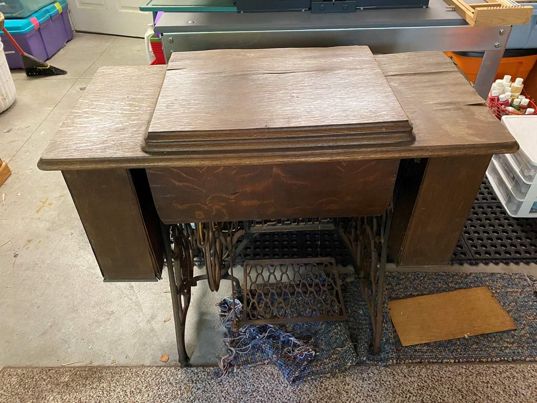 Lot # 35 - Antique Singer Treadle Machine and Cabinet for Decor (main image)