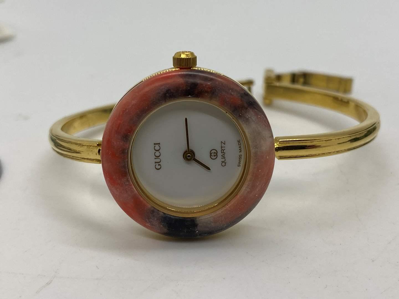 Lot # 91 - GUCCI 1100-L Bracelet Interchangeable Bezel Watch - Circa 1980's (main image)