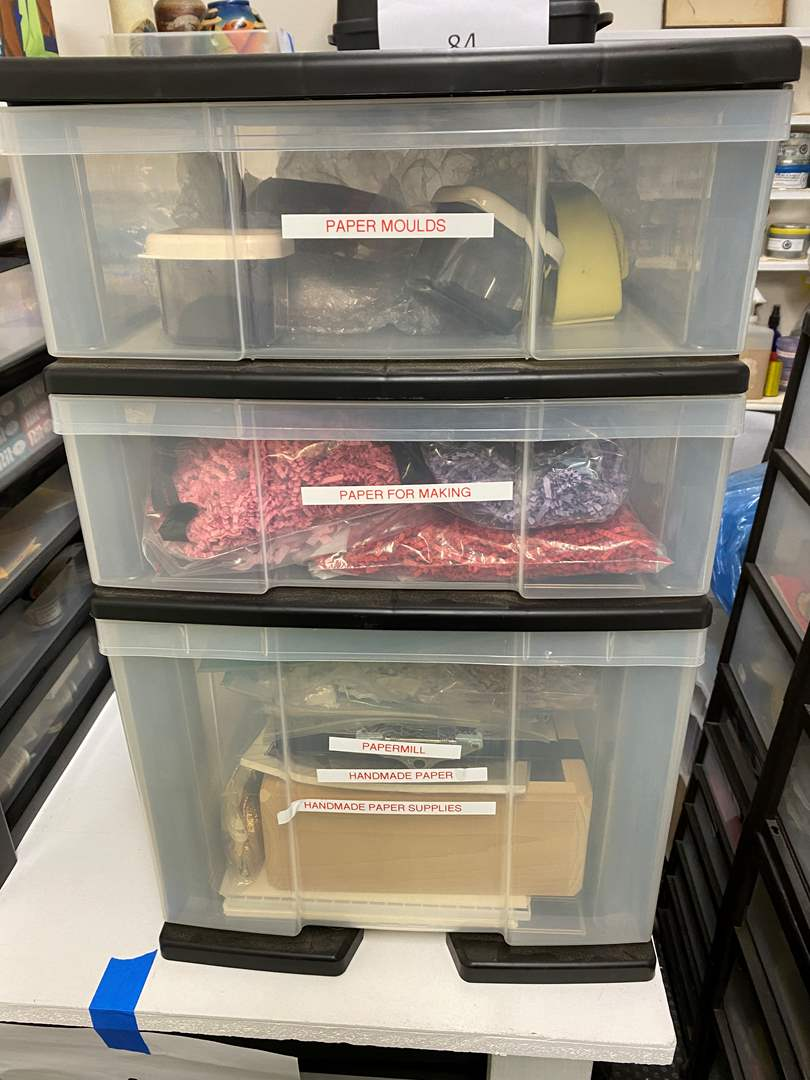 Lot # 245 - 3-drawer cubby full of paper making supplies (main image)