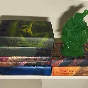 Lot # 338 - Harry Potter Book Series by J.K. Rowling & Buddha