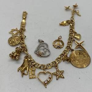 Lot # 132 - 14k Gold Hallmark Charm Bracelet with Diamonds (25.9g)