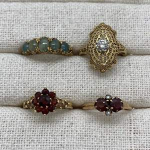 Lot # 134 - 14k Gold with .25c Diamond, 9k Gold Jade Ring, 10k Gold Garnet Rings