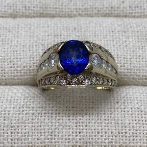 Lot # 401 - Blue Sapphire 2.39 Carats Surrounded by 46 Round Diamonds Set in 14k White Gold - Appraised for $6,342.