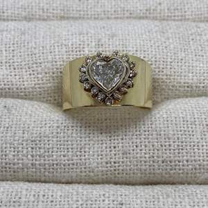 Lot# 402 - 14k Gold Ring with Approximately 1 Carat Heart Shaped Diamond surrounded by diamonds (7.2gTCW)