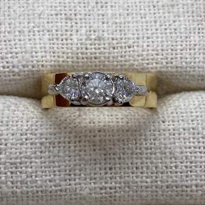 Lot # 404 - Round Brilliant .5 Carat Diamond Flanked by two Heart Shaped .45 Carat Diamonds, 18k Gold Ring (12.4g)