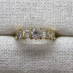 Lot # 405 - 14k Gold Ring with Center Diamond Round Half carat, Two Side Round Diamonds Quarter Carat Each