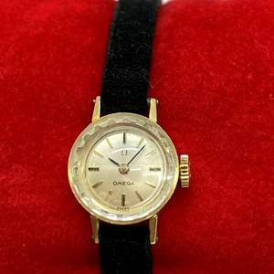 Lot # 416 - Omega 14k Gold Watch with Round Petite Face and Black Suede Band