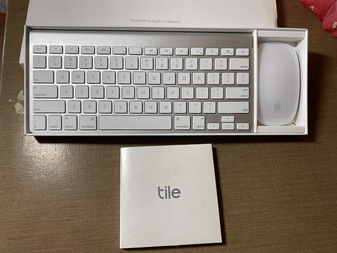 Lot # 469 - Apple Wireless Keyboard, New Tile Set, Ipod and Two Apple Watches (main image)