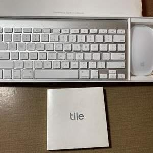 Lot # 469 - Apple Wireless Keyboard, New Tile Set, Ipod and Two Apple Watches