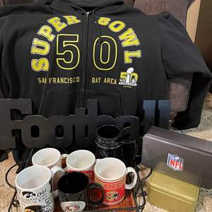 LOT # 33 - New Authentic NFL Superbowl sweater and coffee mugs, tins & Football sign