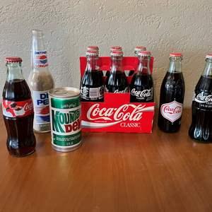 LOT # 44 - Vintage Mt. Dew Soda Can, Pepsi Bottle and Coca-Cola Bottles