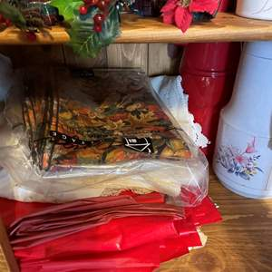LOT # 55 - Table Linens/Kitchen Decorations, Mugs and Coffee Carafes (Contents only)