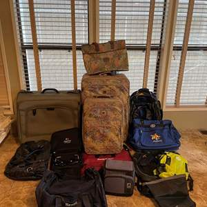 LOT # 57 - Rolling Luggage, Hydration Pack, Leather Bag, Assorted Bags