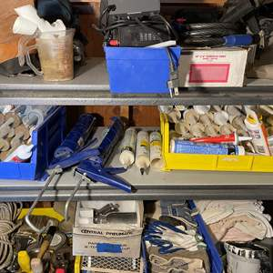 LOT # 150 - Several Caulking Guns With Numerous unused tubes of Different Caulking