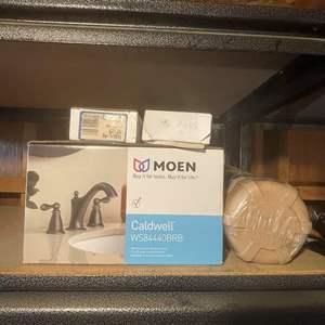 LOT # 164 -New in Box Moen Mediterranean Bronze Finish Faucet Fixture/ Plumbing Products/ Water Filter