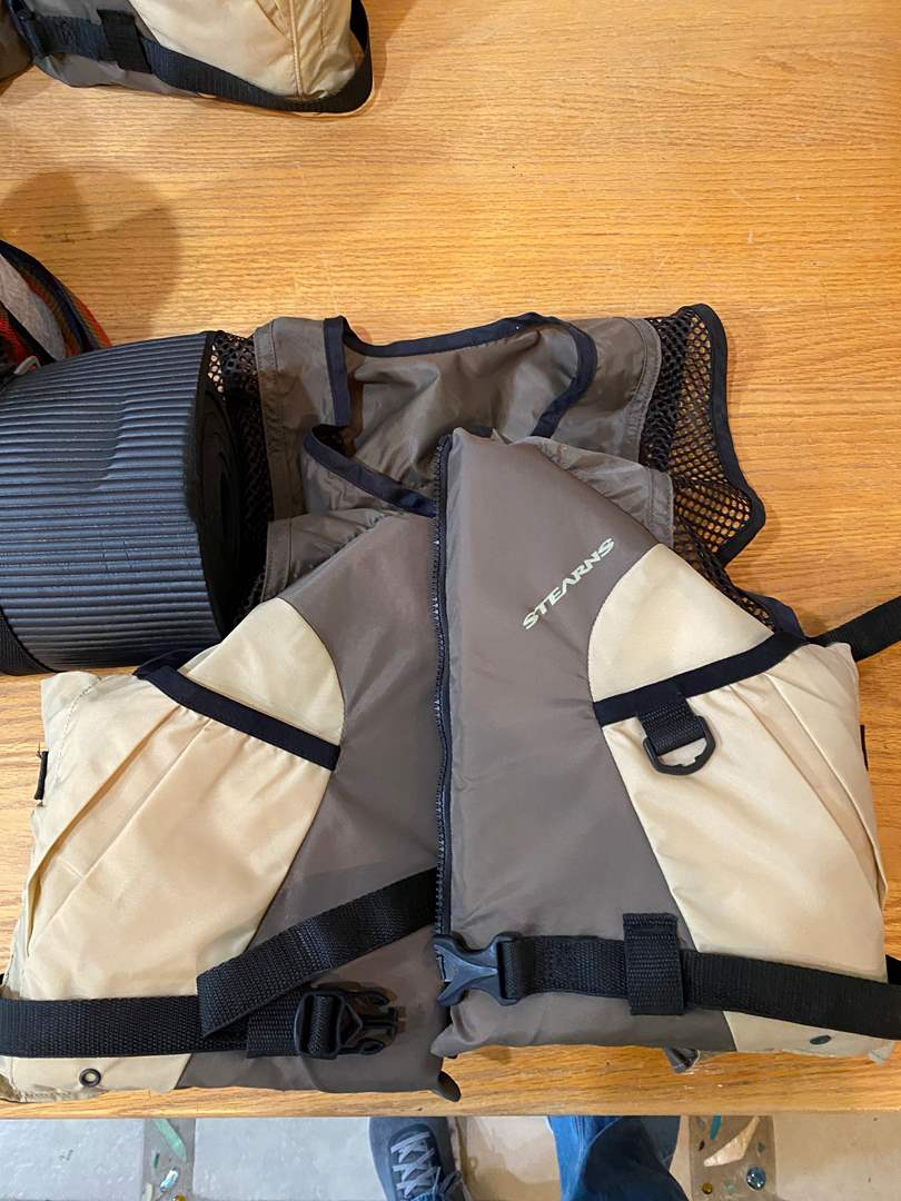 Lot # 179 - Camping Gear - 2 Stearns Life Vests, Stove, Camelback and more - Scouts Pack 214 Fund Raiser (main image)