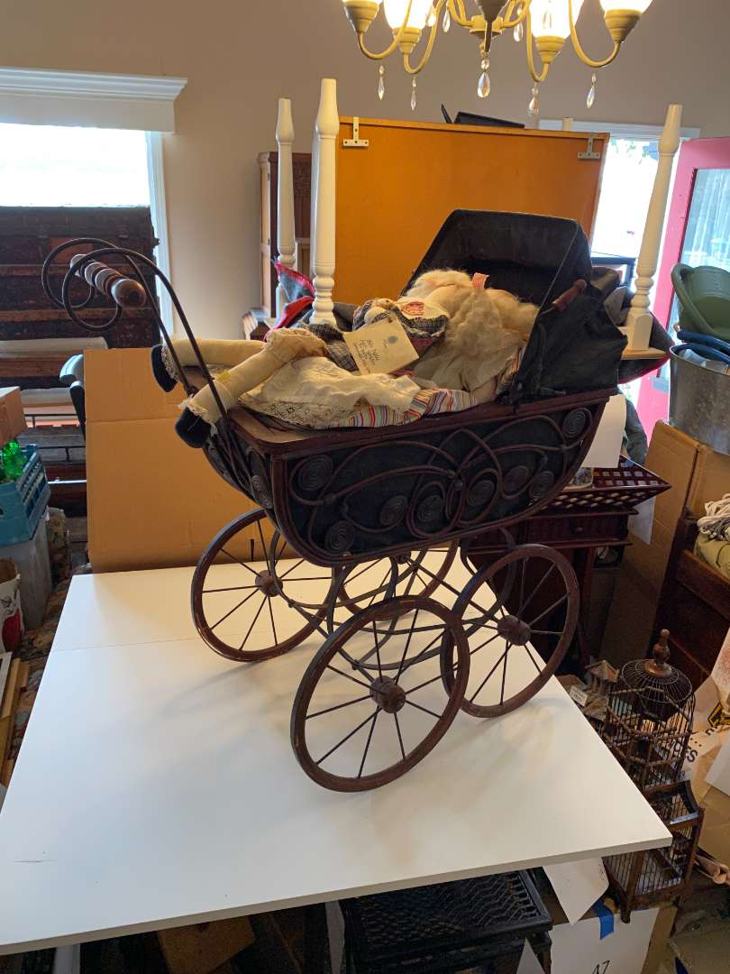Lot # 49 - Vintage Buggy with Dolls  (main image)