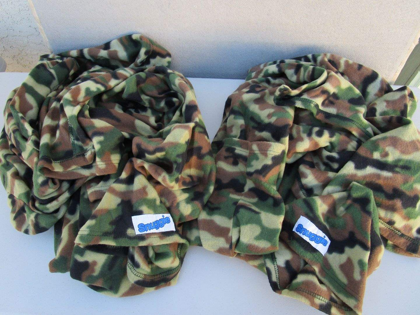 Lot # 119 - 2 Camouflage Snuggie's (main image)