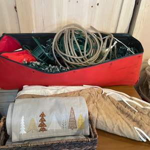 Lot # 48- Outdoor Christmas Lights In rolling storage case/Burlap Christmas Skirt/Wicker Basket/ Table Runner