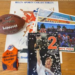 Lot # 12 - Collection of Denver Broncos memorabilia including official team photos and a signed poster by Vance Johnson